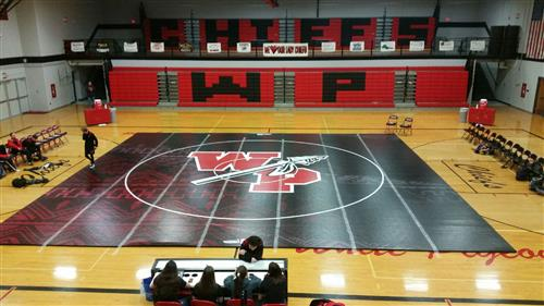 Wrestling Team Unveils New Mat!